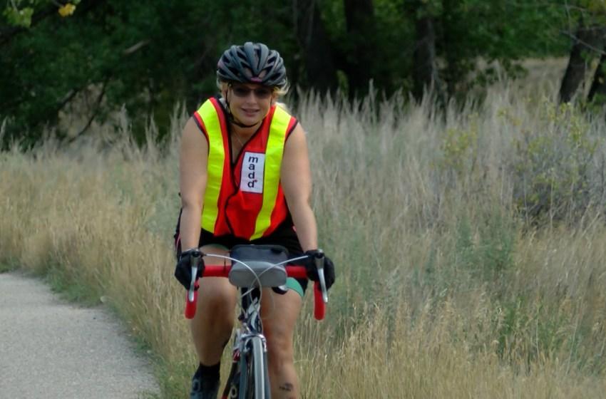 Christina Hendra biking for MADD Canada